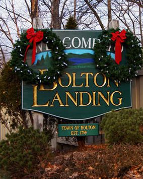 sign saying Welcome to Bolton Landing with two wreaths