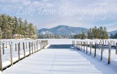 snow on lake george docks