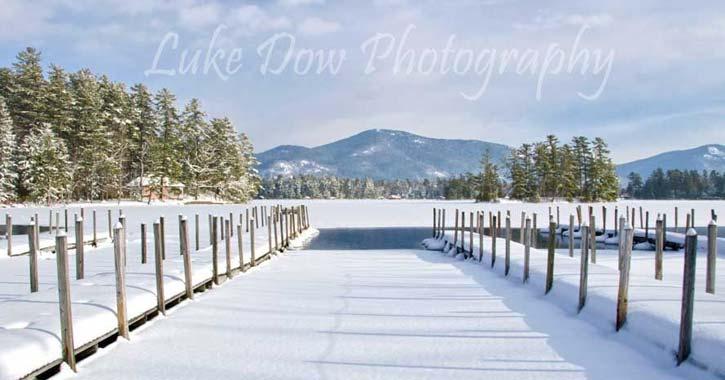 snow on lake george docks
