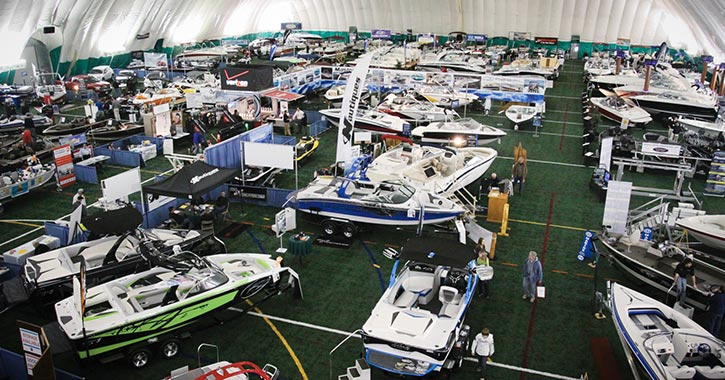 boats on display in a large room