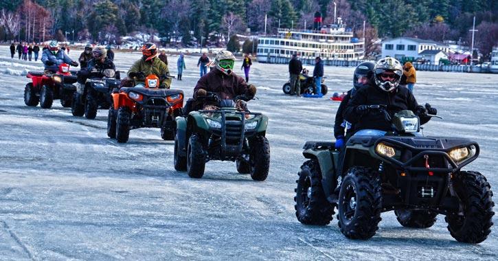 atv riders on a frozen lake