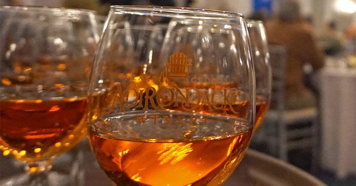 close up of a glass of Adirondack Winery wine