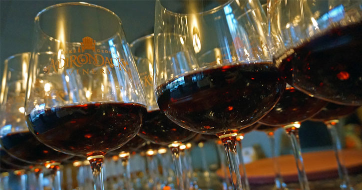 close up of full glasses of red wine