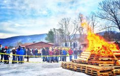large bonfire at a winter festival