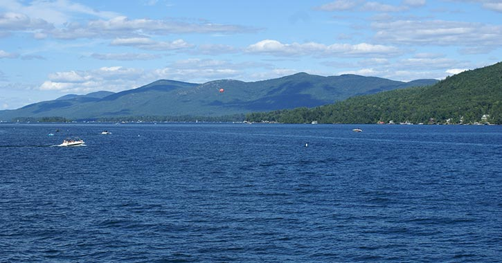 lake george in summer with boat on water