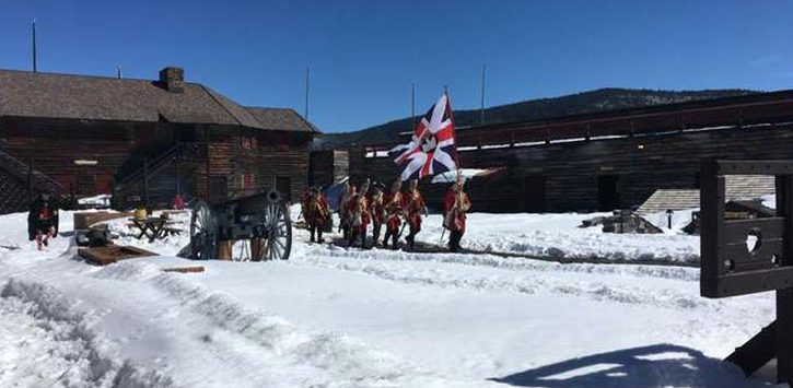 a reenactment in the snow at historic fort