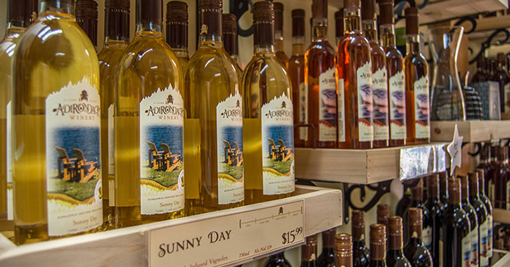 lineup of Adirondack Winery wine on the shelves