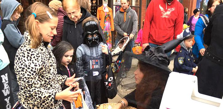 kids getting halloween candy at event