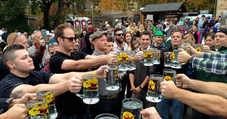 people in a stein hoisting competition