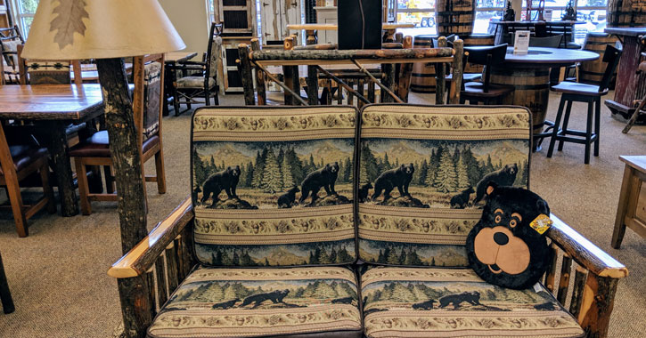 a bear-themed couch in a furniture store
