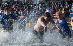 people at a polar plunge