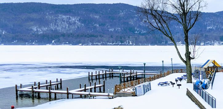 partially frozen lake with docks