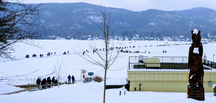 view of people on the ice, large statue of a bear