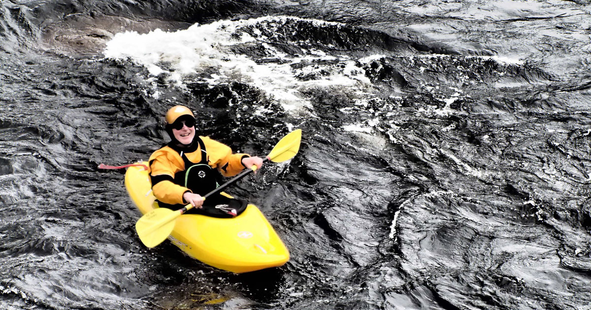 whitewater rafter in yellow