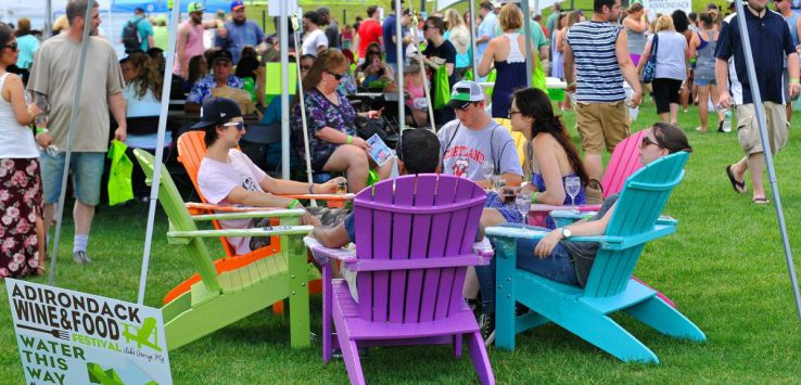 people in Adirondack chairs at the festival