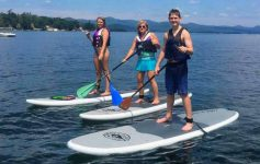 three stand up paddleboarders