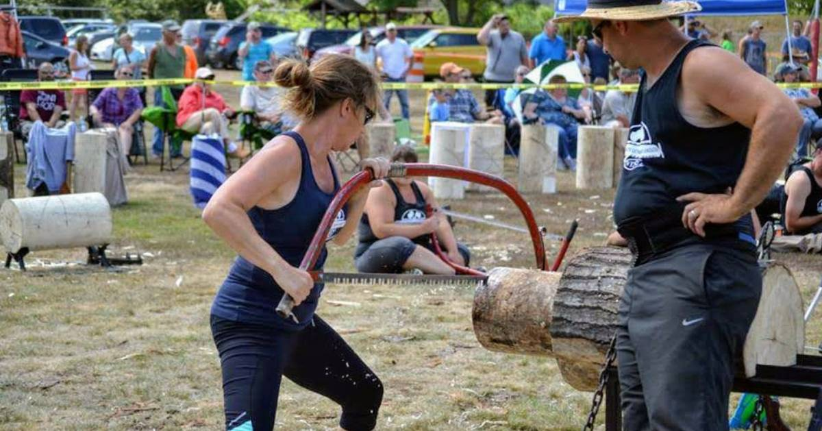 woman sawing lumber