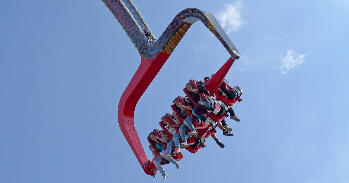 people riding an amusement park ride similar to the adirondack outlaw