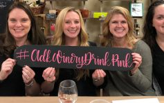 four women with a drink pink sign
