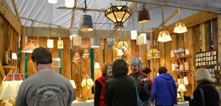 a vendor selling artistic lamps at the larac fall arts festival