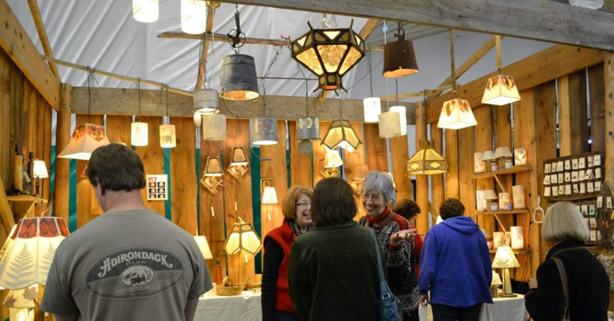 a vendor selling artistic lamps at the larac fall arts festival