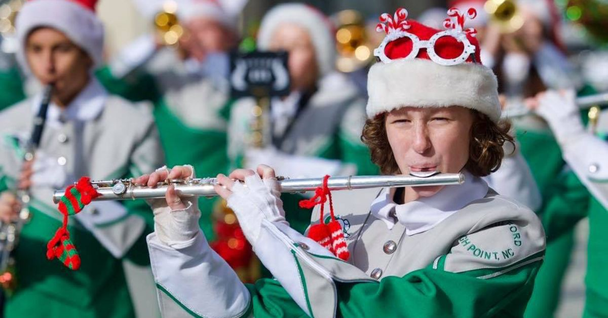 flutist marching in the south glens falls holiday parade