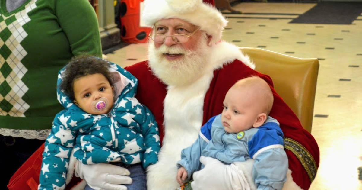 Santa holding two babies