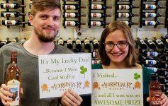 man and woman holding up signs at Adirondack Winery