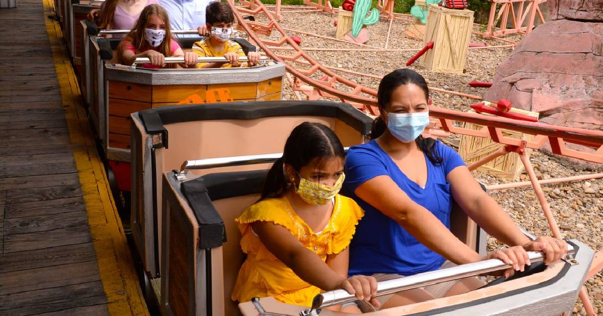 masked people on a ride