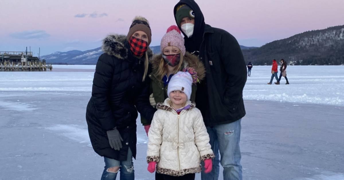 masked family posing on ice