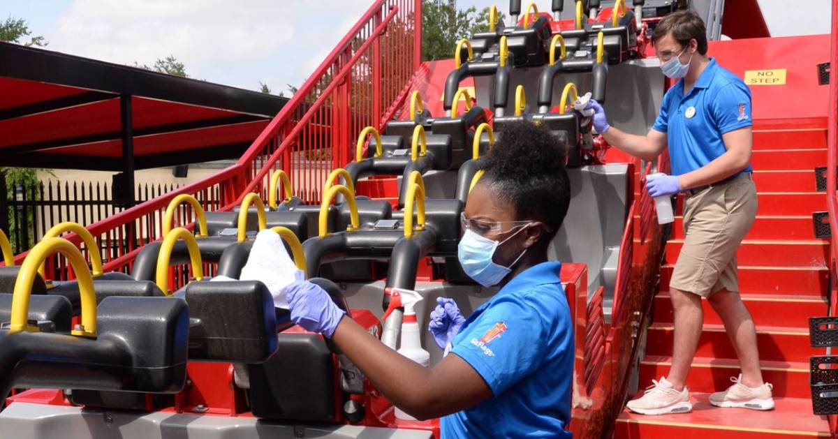employees cleaning a ride