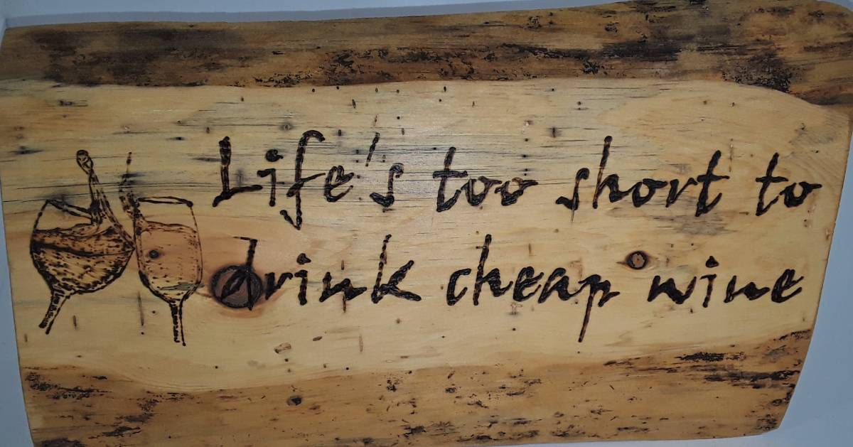 wooden sign that says Life's too short to drink cheap wine
