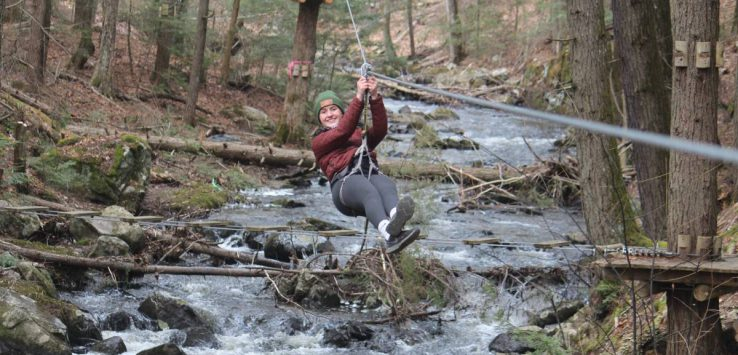 woman ziplines