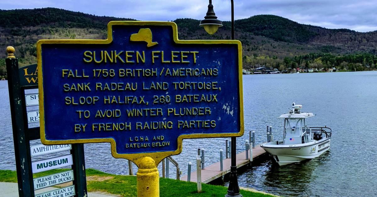 Sunken Fleet sign by lake