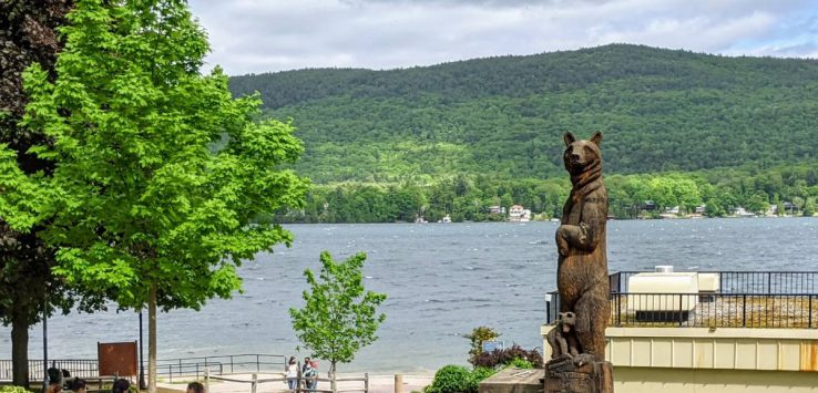 bear statue in park by lake
