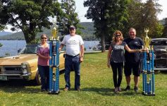 car show winners standing with trophies