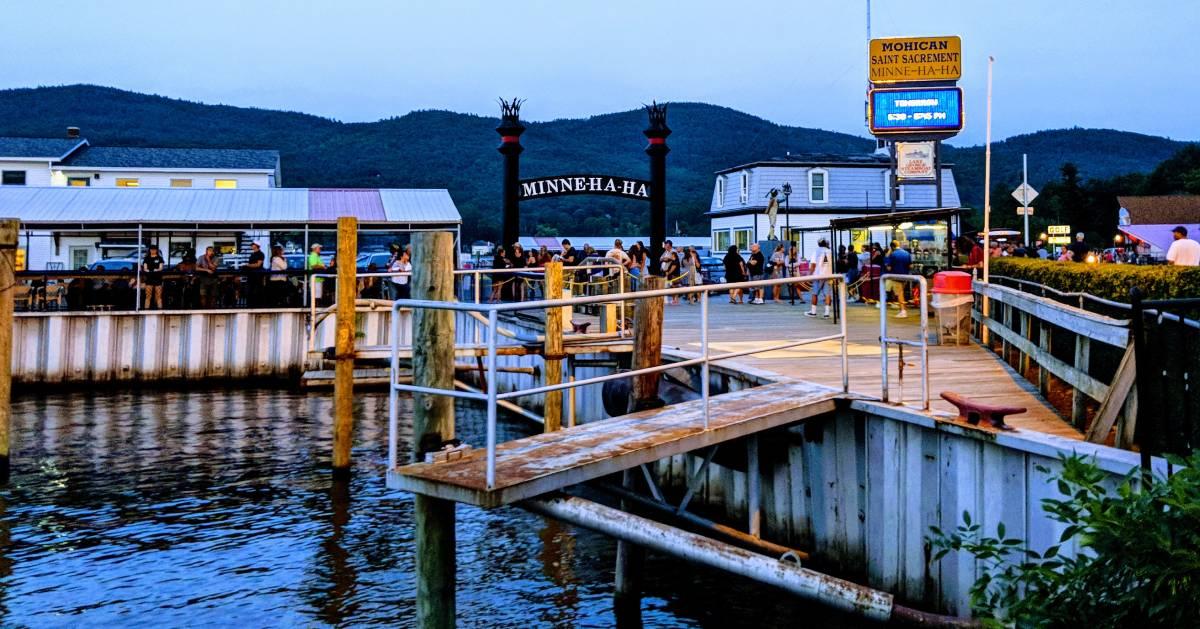 people near docks in Lake George
